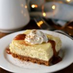 Eggnog cheesecake bars with caramel rum sauce